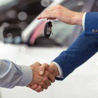 handshake-of-car-buyer-and-salesman-who-is-handing-over-the-keys